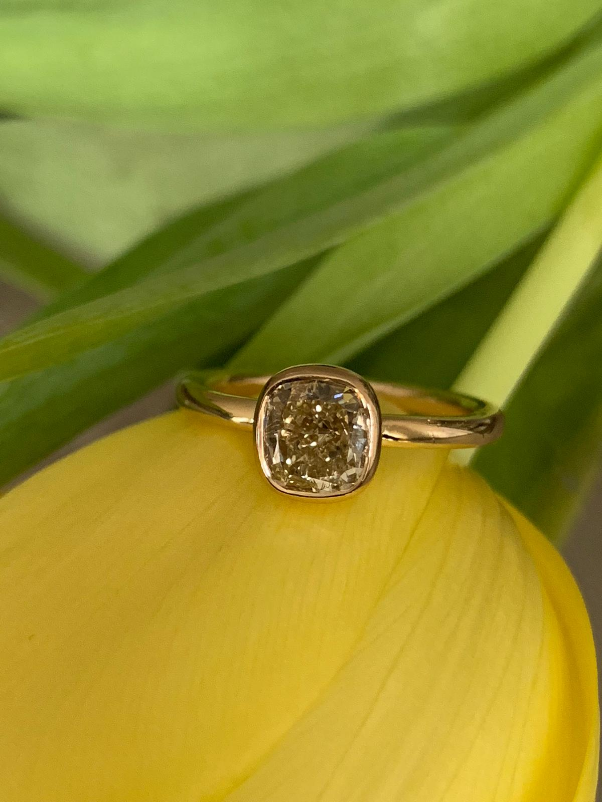 Cushion cut champagne coloured diamond set in yellow gold