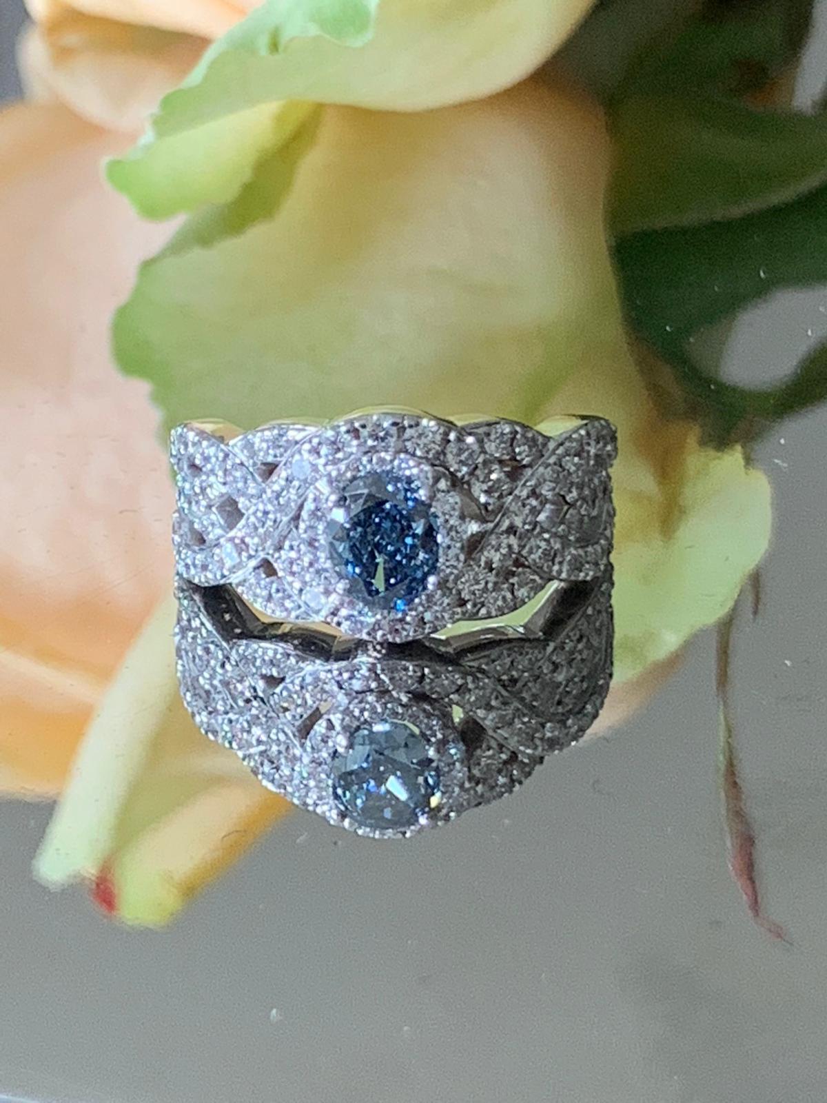 Oval blue diamond in beautiful diamond setting