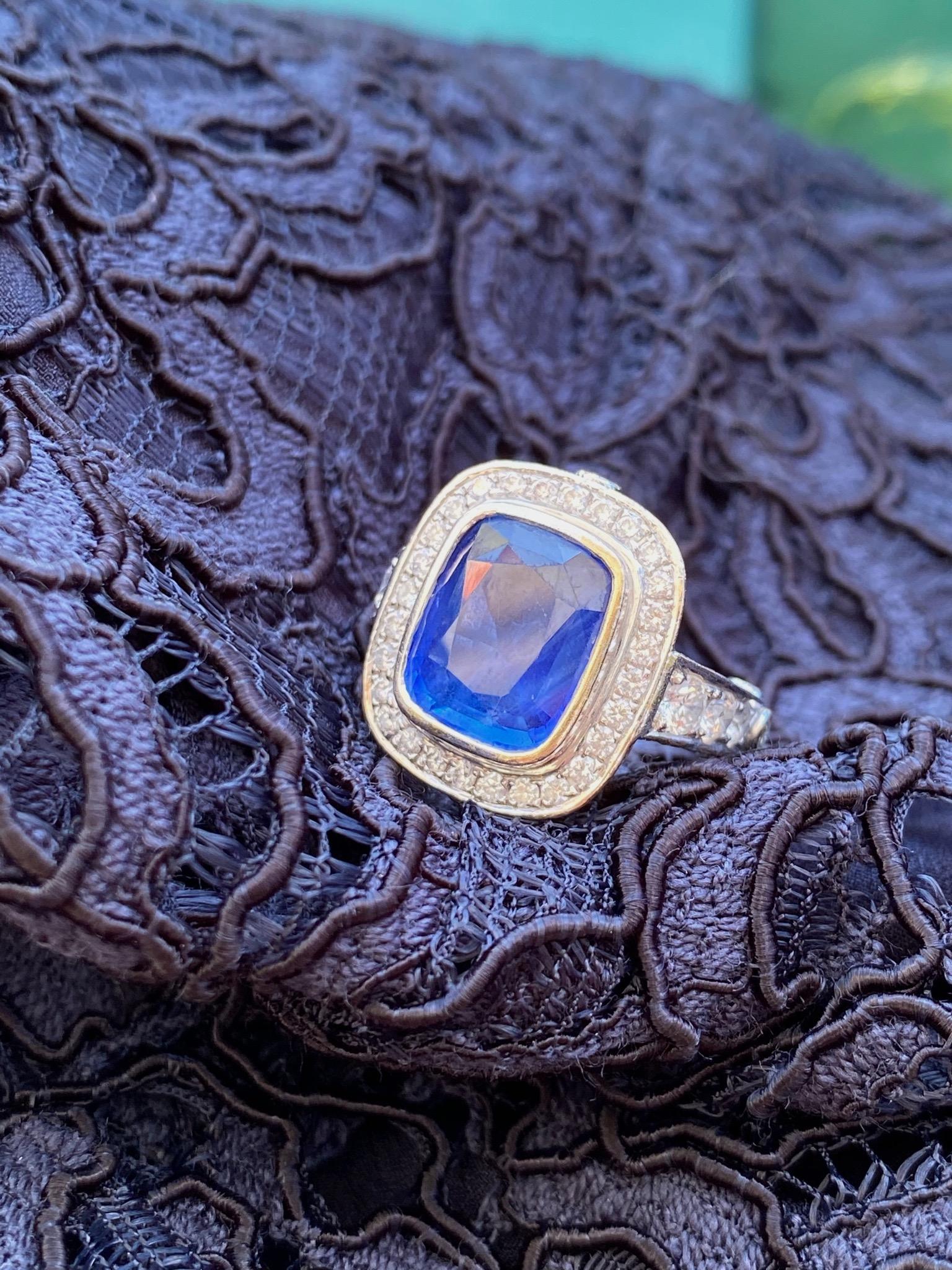5.5 carat blue sapphire set with diamonds