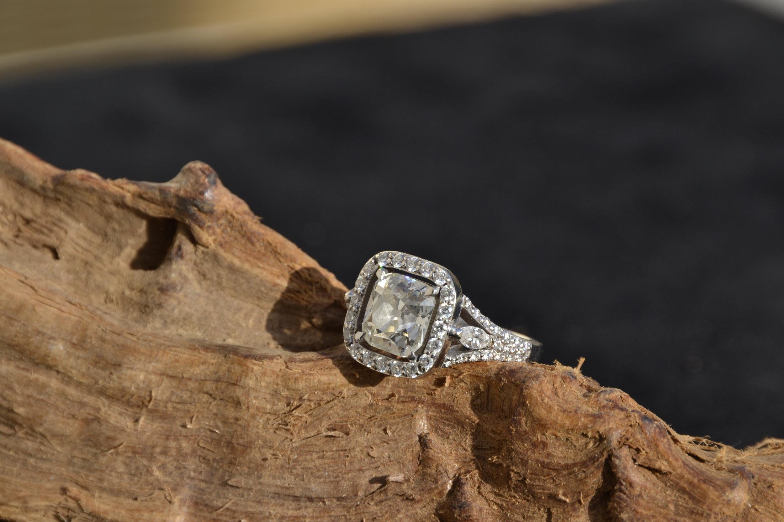 3.3 carat old mine cushion cut diamond set with diamonds