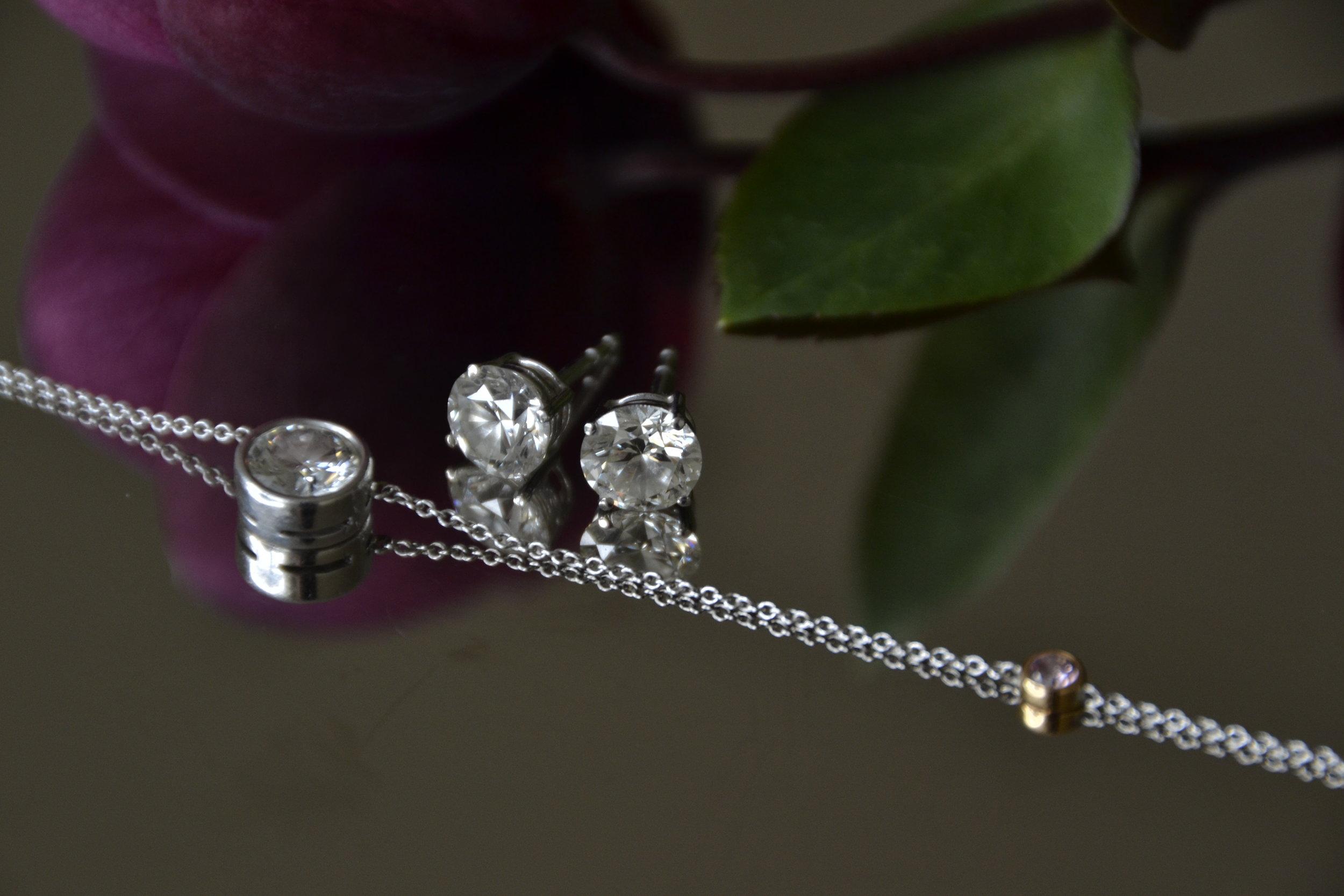 Diamond solitaire earrings, and diamond pendant