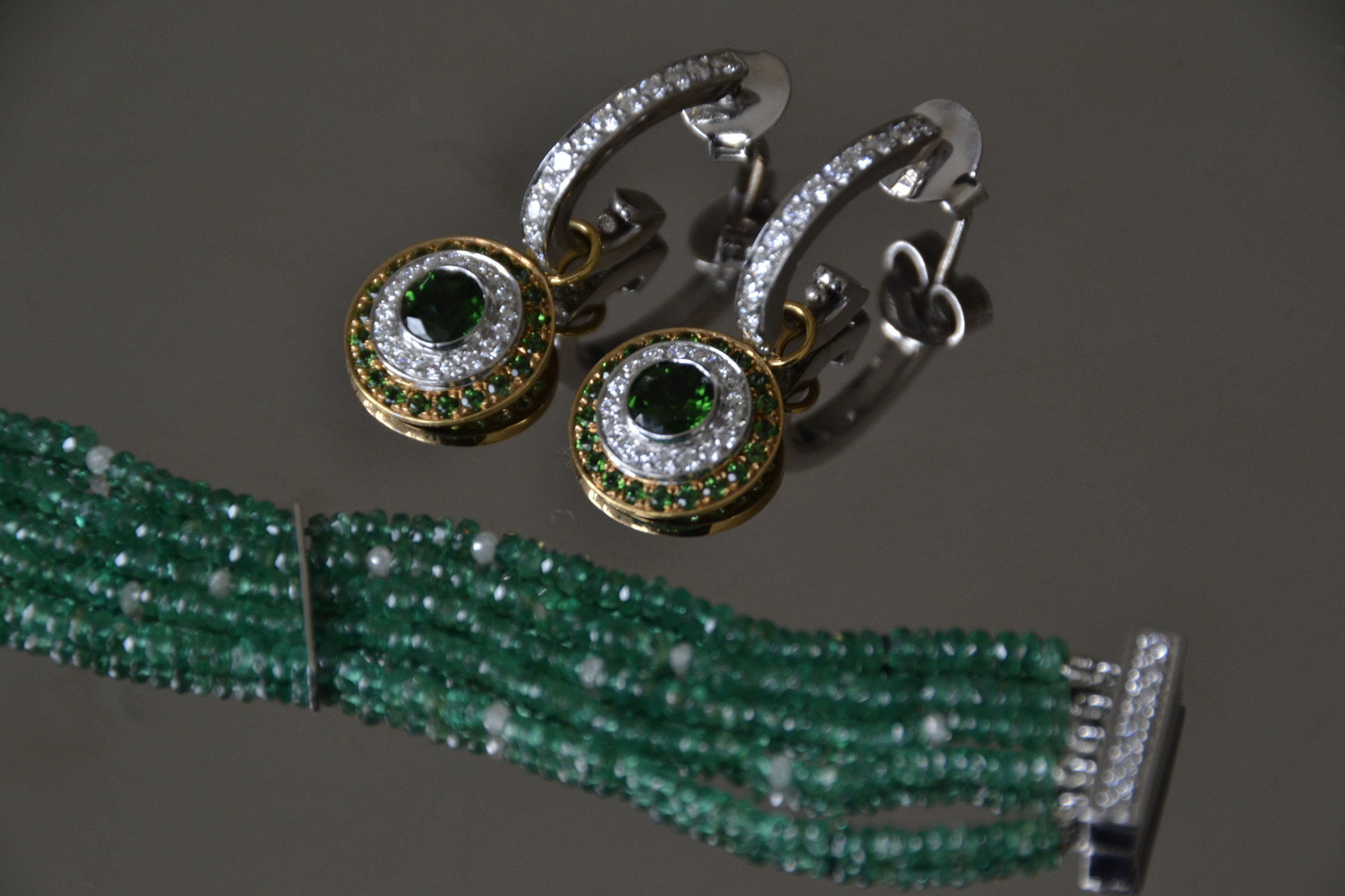 Earrings with green tourmaline and diamonds, bracelet with emerald and diamond beads
