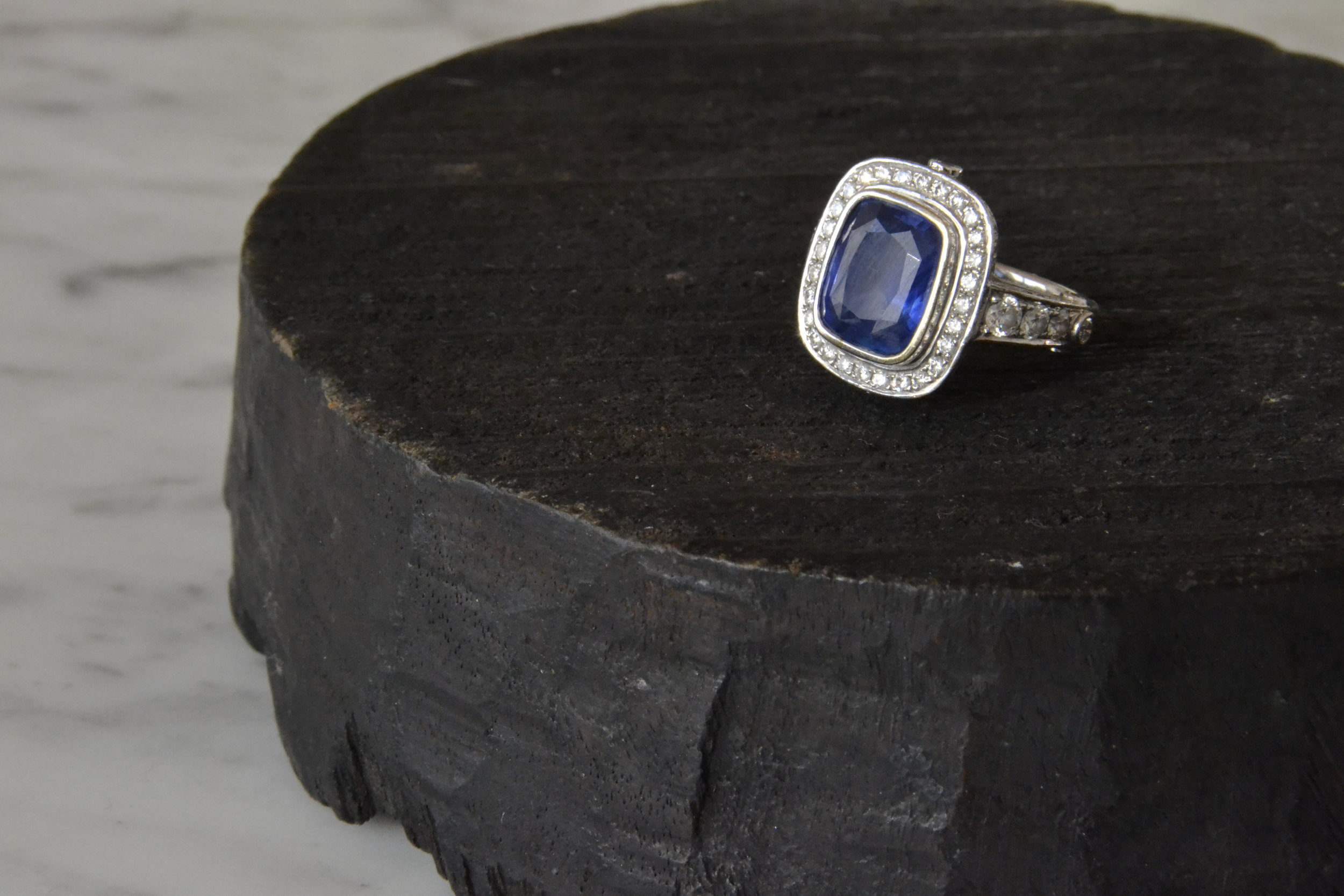 Blue sapphire set with diamonds in white gold