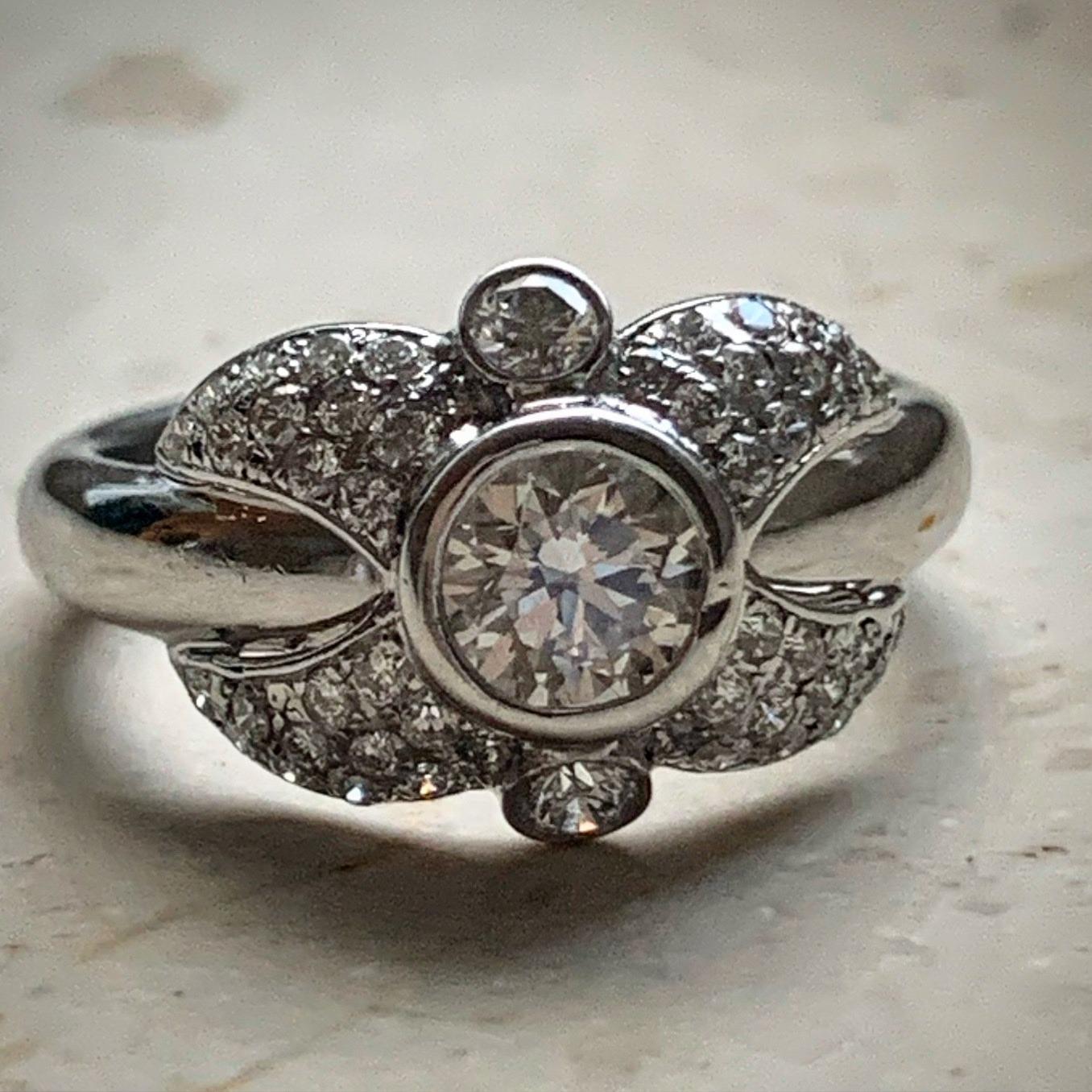 Customized diamond ring with brilliant cut diamond in center