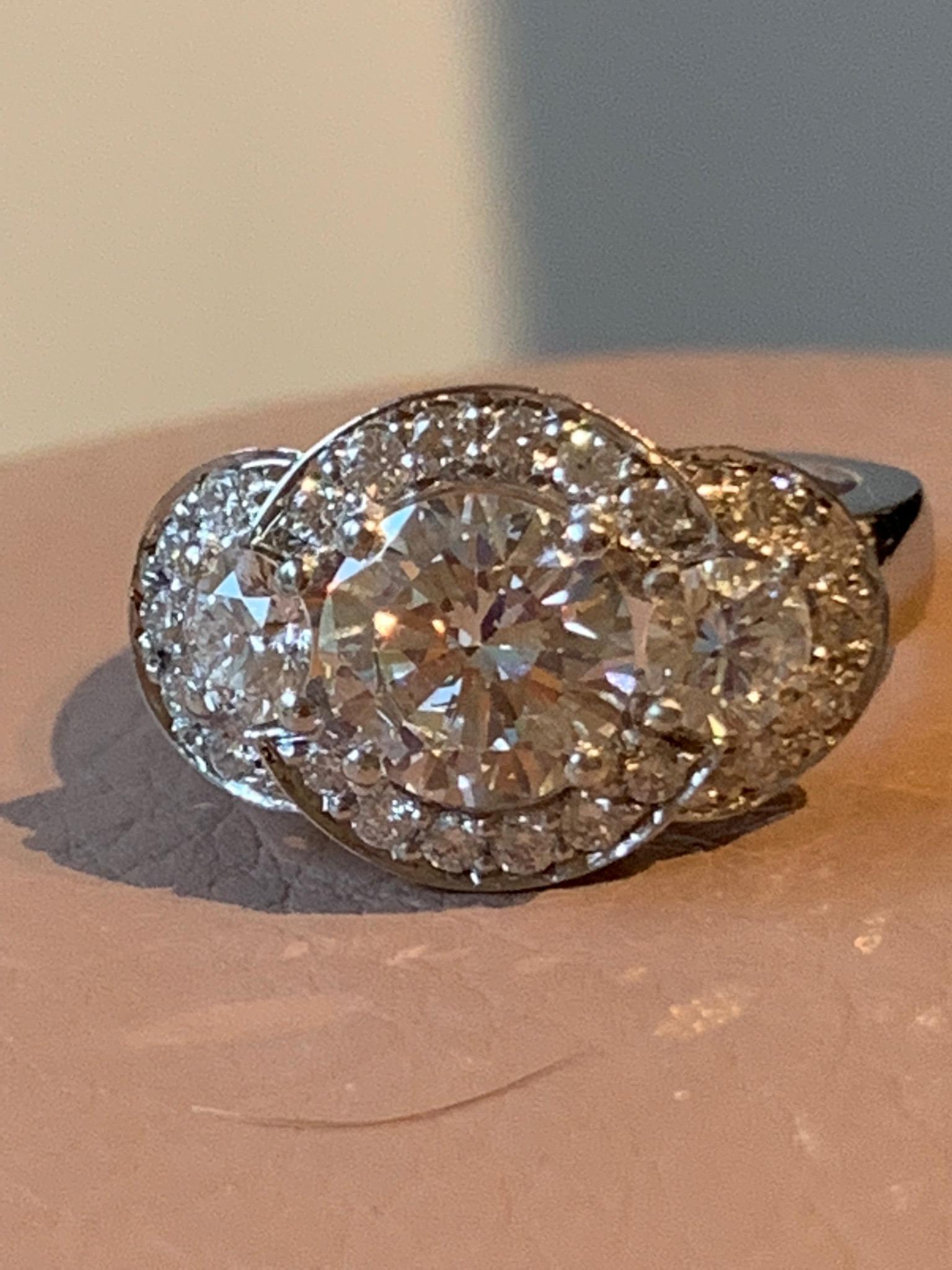 3 stone diamond ring with diamond haloes