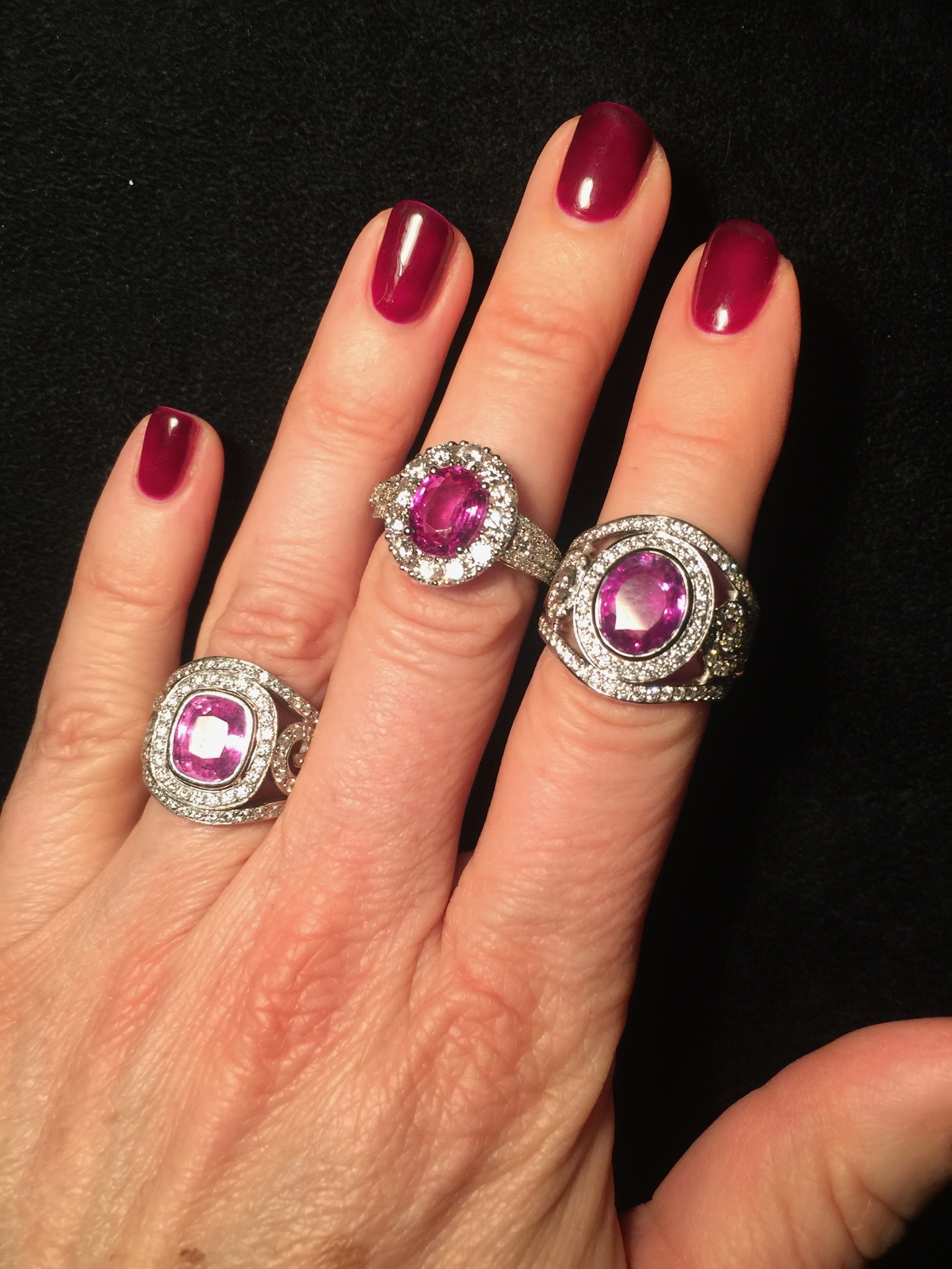 Pink sapphires in different settings, with diamonds