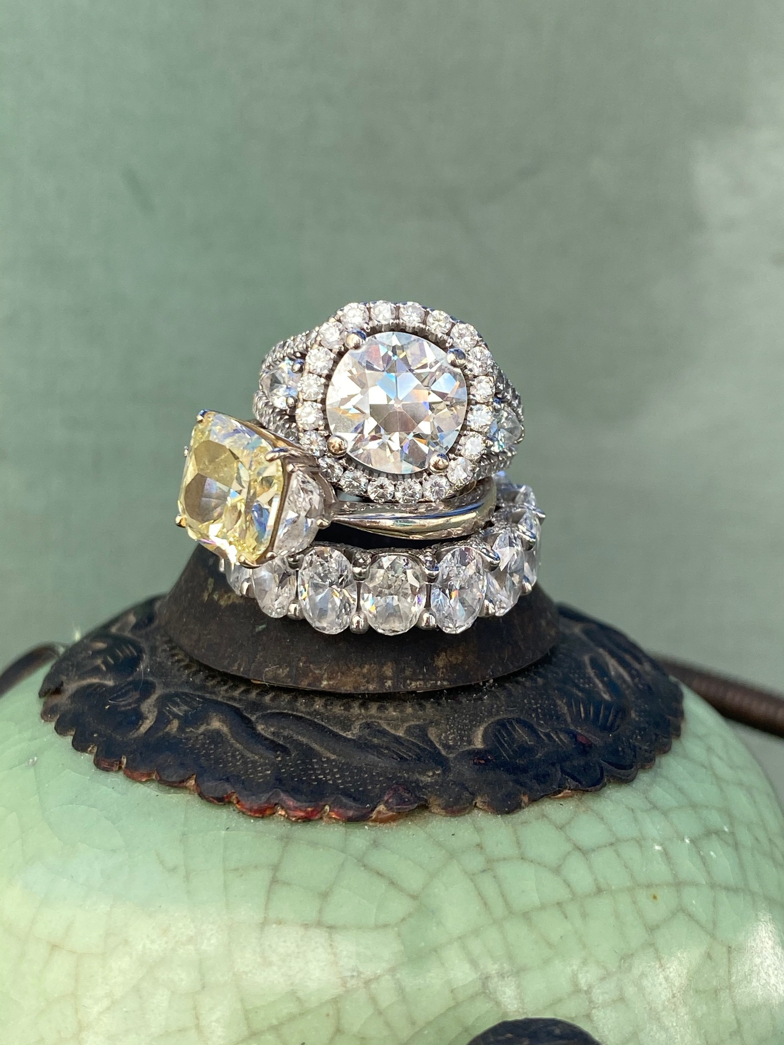 Customized designed rings, eternity ring with oval diamond, 3.3 carat cushion cut yellow diamond ring, and a 3.2 carat old cut diamond ring