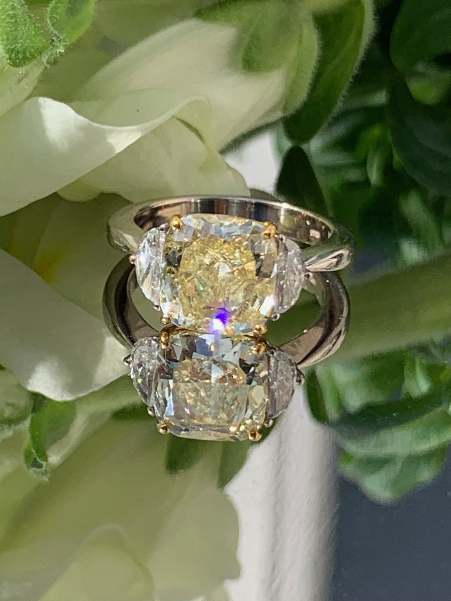 3.3 carat cushion cut yellow diamond set with 2 half moon shape diamonds on side