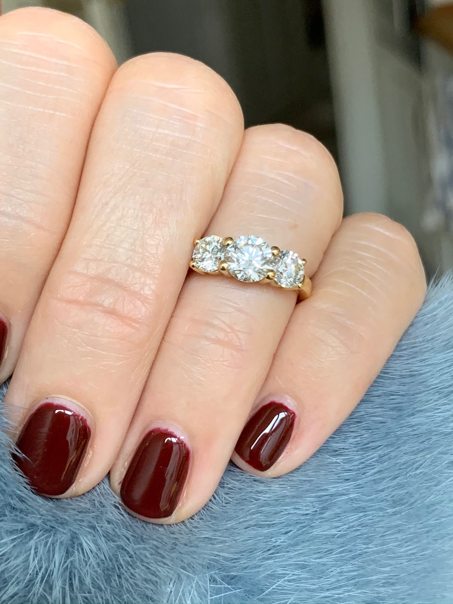 3 stone diamond ring in yellow gold