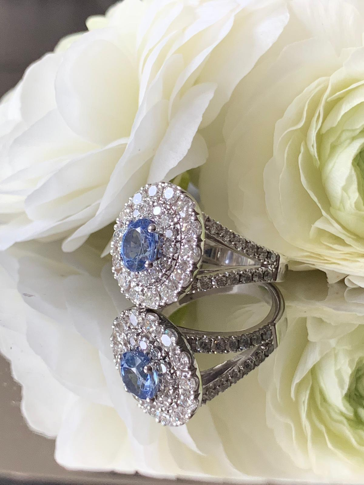 Oval blue sapphire set with diamonds in white gold